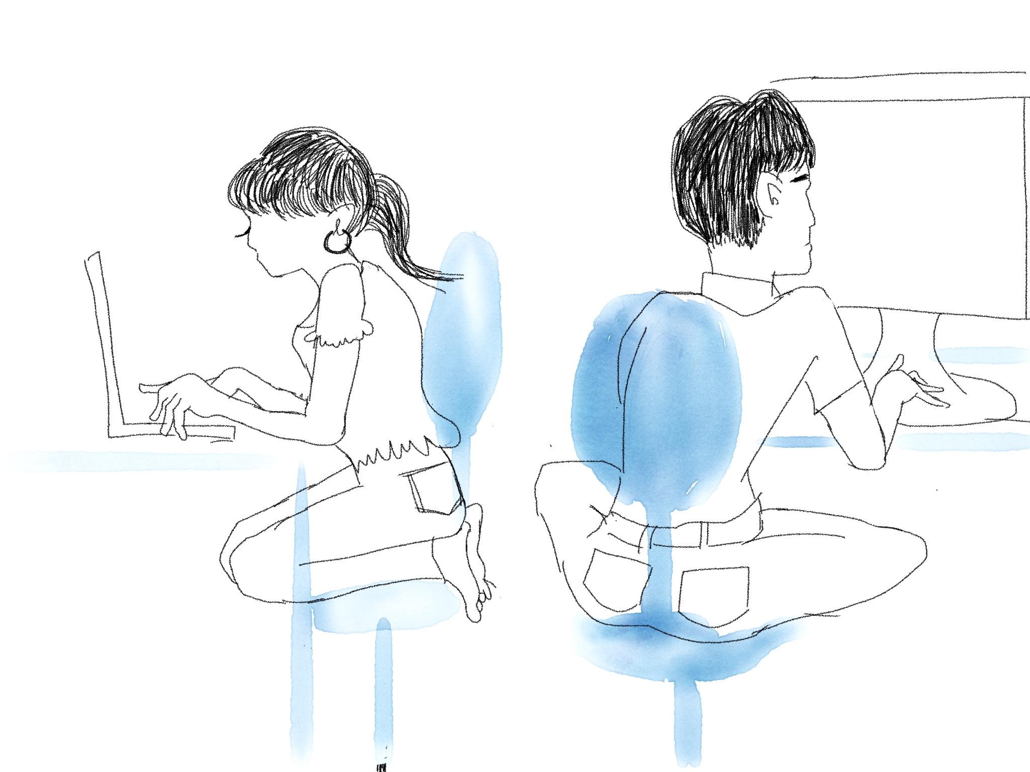 オフィスで足を上げて座る男女